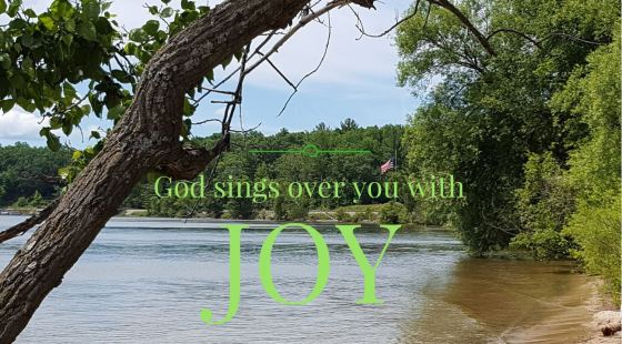 God sings over you with joy
